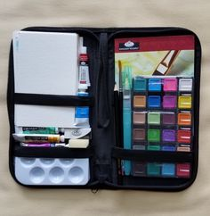 """Watercolor travel case. $9.99 at Joannes Fabric. 6"""" by 11"""". Revamped the inside a bit. Added my own watercolors, brushes and added several different weights of watercolor paper postcard size!"""