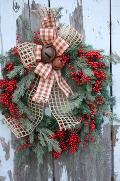 Red Berry and Plaid Christmas Wreath | DIY Christmas Wreaths | Holiday Creative DIY Wreath Ideas, see more at: https://diyprojects.com/diy-christmas-wreaths-front-door-wreath-ideas-you-will-love/