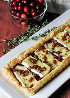 This Cranberry Brie Tart with Pancetta & Thyme is a unique appetizer that's perfect for the holidays! It's a delicious twist on a traditional baked brie. easy appetizers Cranberry Brie Tart with Pancetta & Thyme Good Food, Yummy Food, Tasty, Snacks Sains, Savory Tart, Savoury Tart Recipes, Savoury Baking, Think Food, Appetisers
