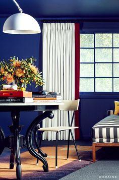 Dining room with cobalt walls and big floral arrangement