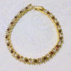 Vintage Gold Tone Red and Clear Rhinestone Tennis Bracelet by BorrowedTimes on Etsy