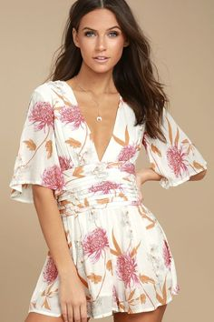 The MINKPINK Day Dreamer White Floral Print Romper is better than we could have ever imagined! Pink, orange, and light blue floral print woven fabric forms this playful romper with a plunging neckline, and short sleeves. Pleated, set-in waist tops relaxed shorts. Hidden back zipper/clasp.