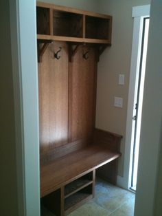 Mud room bench.  Heidi, if we build one of these, it may be easier to hang those dang hooks !