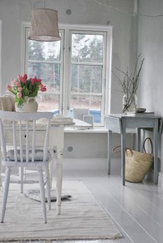 So clean and white, yet still homey with a touch of flowers.
