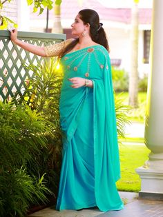 ASTER #Laksyah #soft_crepe #teal_colored #ornate_saree #carved_blossom_design #mirror #beads #zardosi