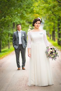 Real wedding in Finland. Dress made by Pukuni (www.pukuni.fi). Wedding dress with off shoulders sleeves and soft tulle. Photography / J-P Tuhkanen.