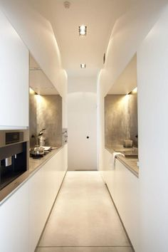 gorgeous white small galley kitchen with silvered splashbacks - architect Bart Lens