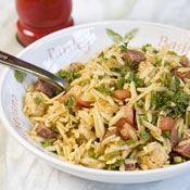 Paella Salad Recipe at Cooking.com -- This orzo salad is bursting with the flavors of paella.  A good alternative to standard pasta salads for the next potluck.