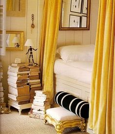 Sleep beside them.  -- that is what my bedside used to look like. Until I turned the dining room into a library.