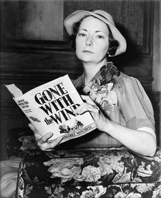 Margaret Mitchell holding her book, Gone With the Wind, ca. 1938.