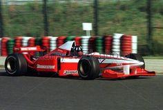 World Champion Damon Hill drives the Bridgestone Tyre Test Car (TWR Ligier Mugen-Honda at the Suzuka Circuit. Bridgestone Tires, Damon Hill, Formula 1, F1, Circuit, Honda, Champion, November
