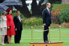 Britain's Prince William takes a Royal Salute watched by Catherine, Duchess of Cambridge, and the Governor General of New Zealand Sir Jerry Mateparae, at the official welcome at Government House, in Wellington, New Zealand, Monday, April 7, 2014.
