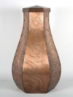 John Greco Urns has created the Cloud Toulouse, a custom copper urn of the standard Toulouse design but embellished with a cloud design inspired by Chinese vases dating back to the Ch'ing Dynasty.