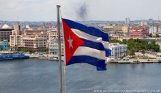 Real Cuba - Cuban flag flying over Havana by Andrew Wragg, via Flickr