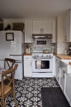 Retro kitchen appliances. White kitchen cabinets. Beveled subway tile. Patterned floor tile.