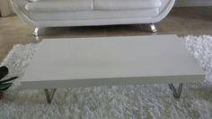 White Coffee Table.  Great condition. Moving..have to sell all furniture.