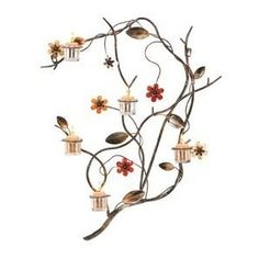Designer candle holders to decorate wall to enhance interior.  http://www.homedecorationtips.org/2011/10/decorate-home-walls-sconce-candle-holder/