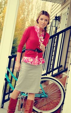 Remember to use the dark fuchsia cardigan over the pink striped shirt, with a dark belt, to copy this look.