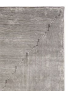 Serena's fascination with geometric patterns led to this striking design. We love how the interplay of the lines evokes four distinct shapes. Beautifully handwoven and an instant statement-maker.