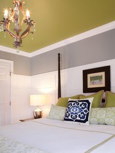 Look-at-me green on the ceiling updates this traditional bedroom.