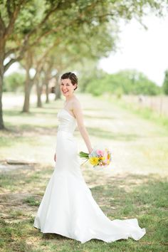 Bright Florals, Blue Bridesmaid Dresses, College Station Wedding ©Jennefer Wilson