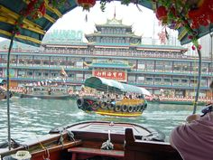 """""""Riding a a sampan"""":  Sampan, a small boat for short voyages, usually for a couple of minutes, like this one.... the picture was taken in Aberdeen, Hong Kong."""