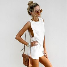 All white, tans, shades, messy bun & big hoops