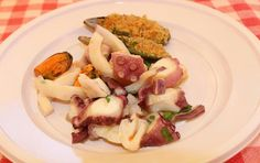 baked mussels and octopus salad, Sicilian food..  Cefalu Sicily, Italy