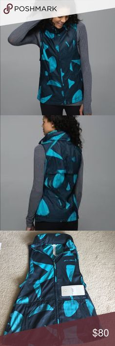 Lululemon Pack It Vest This loose, lightweight vest is a true chameleon. Feeling toasty? Roll it into a pocket for the ultimate stow-and-go. Temperature drops? Pull out the hidden hood. It even has a cinchable waist so you can adjust the fit. You come and go, you come and go! fabric + features perforated Glyde fabric for added ventilation stow the hood into the collar low armholes for freedom of movement reflective details help keep you bright in low light. This is NEW with tags attached…