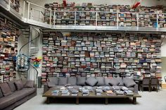 Karl Lagerfield's Personal Library: Not as cozy as I would pick for my own, but I would pay money to look through those titles… that's a LOAD of books, folks! Aren't you the least bit curious what is on those shelves?