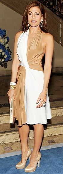 Who made Eva Mendes' satin pumps, jewelry, and halter two tone dress that she wore in New York?