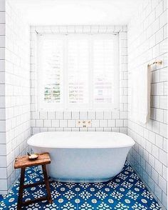 Beautiful blue and white patterned tile bath. Dreamy!