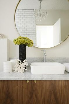 OR just a large, thin/simple/distressed frame mirror for powder room.  danielle oakey interiors