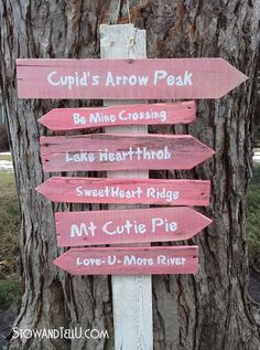 A DIY Valentine's Day inspired trail sign made from pallet slats stained with red food coloring.