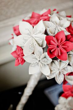 Have someone crafty make a paper-flower bouquet for the bride-to-be.  Photo by First Comes Love Photo via Style Me Pretty