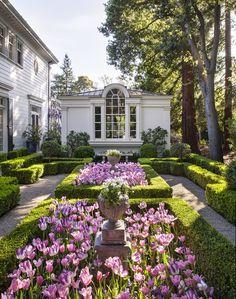 Best Landscape & Garden Design:  A Classical Peninsula Garden designed byElizabeth Everdell Garden Design  Photography by Michele Lee Willson Photography