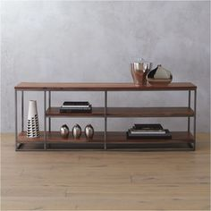 Shop framework open shelf credenza. Architectural three-tier structure entertains in the raw. Braced by sleek iron frame, wide planks of solid sustainable acacia wood show beautiful light-to-dark tones, active grain and naturally occurring knots.
