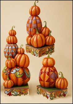 Jim Shore Heartwood Creek Thanksgiving Collection  Stacked Pumpkins  Set of 3 Figures    As a centerpiece or room decor, these three pumpkins are the perfect decoration for Halloween or Thankgiving.    Specifications:  Materials: Stone Resin   Note: Unique variations should be expected; hand painted        Your Price: $67.00