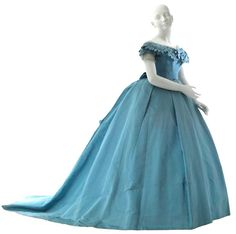 Charles Frederick Worth, cerulean blue silk evening gown, 1866-67. Pleated tulle ruffle at neck and sleeves, self trim at neck, train, self belt with horizontal pleats. Museum of the City of New York.