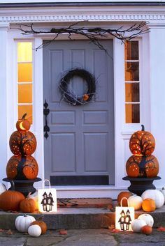 Deck out the front door with a pair of pumpkin pillars. Paint on gnarled trees, and then use a drill to create a constellation of stars. For a third tier, cut out a crescent moon on a mini pumpkin. Get the tutorial » What you'll need: cordless drill ($58, amazon.com), black paint ($7, amazon.com)