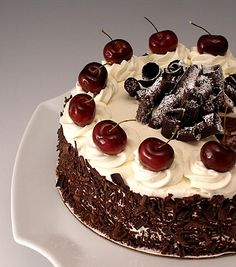 Black Forest Cherry Cake (Schwarzwalder Kirschtorte)_ is loaded with chocolate and cocoa ingredients from Hershey's Black Forest Torte Recipe, Black Forest Cherry Cake, German Black Forest Cake, No Bake Desserts, Delicious Desserts, Stabilized Whipped Cream, Cake Recipes, Dessert Recipes, Fudge Cake
