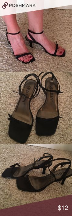 Strappy black heels in good shape Fun or formal these black shoes are delicate. Bow detail near the toes ankle strap. In good shape. Heel height is 2.5 inches Sam & Libby Shoes Heels