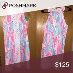 Lilly Pulitzer dress This dress is PERFECT for any type of summer event! You could wear it to a wedding, on vacation, for summer beach photos, etc. The possibilities are endless in this straight-fitted sailboat Lilly favorite! It has never been worn and is in perfect condition! Lilly Pulitzer Dresses Midi