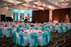 turquoise and red wedding chairs | Red and aqua seating arrangement