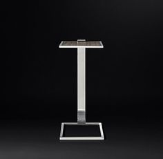 RH's Franz Wood & Metal Rectangular Side Table:Our table's slim cantilevered form reflects the influence of modern architecture on midcentury design. Smooth, fine-grained wood veneer serves as a counterpoint to the cool metal frame.