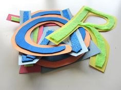 Make Textured Letters - construction paper or card board, glue, textures (felt, foam, sandpaper, cotton balls, beans, sand, coarse salt,etc)