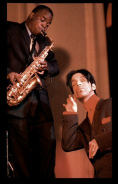 Prince being silly as he listens to saxophonist Maceo Parker - who was also the saxophonist in Janes Brown's band.