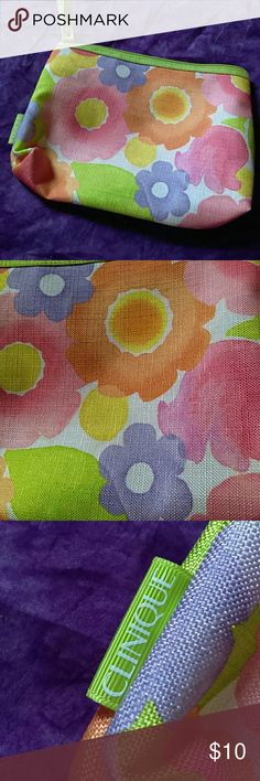 Colorful Flower Clinique Make Up Bag With Strap Colorful Flower Clinique makeup bag with strap. Outside in great condition! Inside has very few hardly noticeable marks. Thanks for viewing my listing! Any questions please feel free to ask. Happy poshing! Clinique Bags Cosmetic Bags & Cases
