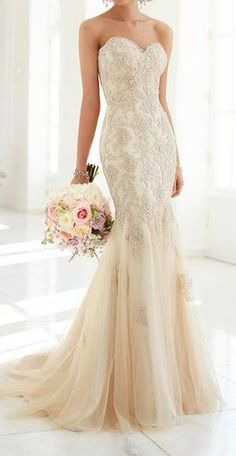 This modified fit-and-flare wedding dress with a sweetheart neckline is the best of both worlds - a fashion-forward silhouette with vintage-inspired details.