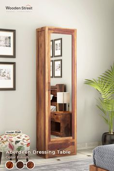 Elegant Design. One drawer at the bottom, six shelves behind the doors, and a full-size mirror make enough space for all your beauty essentials. A perfect way to ease out your beauty sessions. This finely crafted Sheesham wood unit, sporting a slatted design, is available in three different finish options, including honey, teak, and walnut.  #woodenstreet #furniture #dressingtable #livingroomdecor #homedecor
